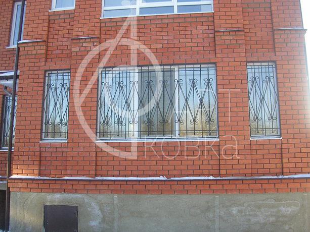 Кованые решетки на окна Винд 09