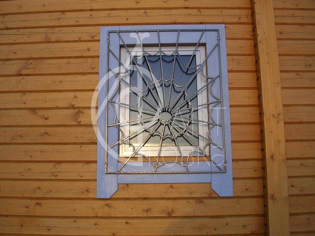 Кованые решетки на окна Паутина